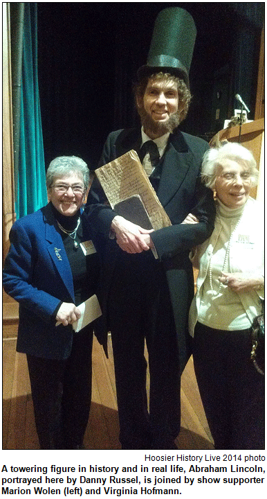 A towering figure in history and in real life, Abraham Lincoln, portrayed here by Danny Russel, is joined by show supporter Marion Wolen (left) and Virginia Hofmann. Hoosier History Live photo.