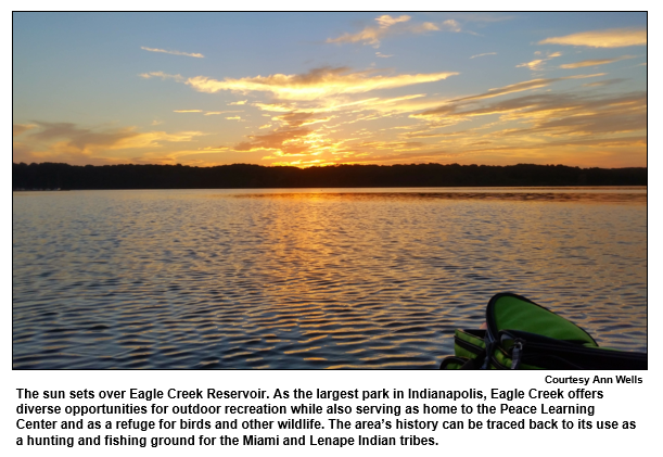 The sun sets over Eagle Creek Reservoir. As the largest park in Indianapolis, Eagle Creek offers diverse opportunities for outdoor recreation while also serving as home to the Peace Learning Center and as a refuge for birds and other wildlife. The area's history can be traced back to its use as a hunting and fishing ground for the Miami and Lenape Indian tribes.   Courtesy Ann Wells.