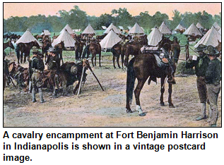 A cavalry encampment at Fort Benjamin Harrison in Indianapolis is shown in a vintage postcard image.