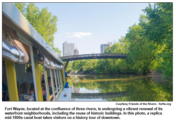 Fort Wayne, located at the confluence of three rivers, is undergoing a vibrant renewal of its waterfront neighborhoods, including the reuse of historic buildings. In this photo, a replica mid-1800s canal boat takes visitors on a history tour of downtown.  Courtesy Friends of the Rivers.