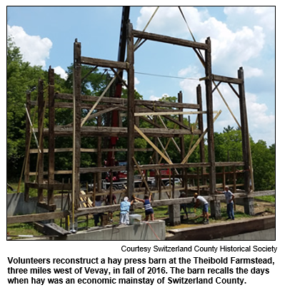 Volunteers reconstruct a hay press barn at the Theibold Farmstead, three miles west of Vevay, in fall of 2016. The barn recalls the days when hay was an economic mainstay of Switzerland County. Courtesy Switzerland County Historical Society.