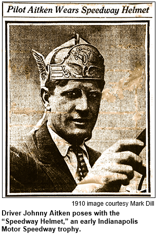 Driver Johnny Aitken poses with the Speedway Helmet, an early Indianapolis Motor Speedway trophy. 1910 image courtesy Mark Dill.