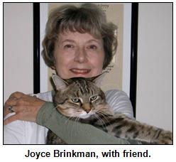 Joyce Brinkman with Bobb, her cat.