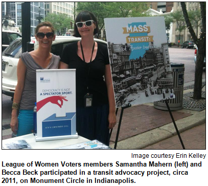 League of Women Voters members Samantha Mahern (left) and Becca Beck participated in a transit advocacy project, circa 2011, on Monument Circle in Indianapolis. Image courtesy Erin Kelley.