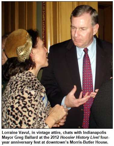 Lorraine Vavul, in vintage attire, chats with Indianapolis Mayor Greg Ballard at the 2012 Hoosier History Live! four-year anniversary fest at downtown�s Morris-Butler House.