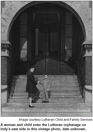 A woman and child enter the Lutheran orphanage on Indy's east side in this vintage photo, date unknown. Image courtesy Lutheran Child and Family Services.