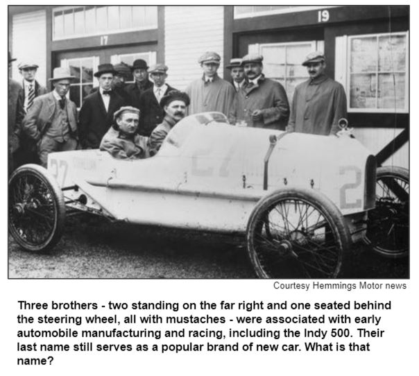 Three brothers - two standing on the far right and one seated behind the steering wheel, all with mustaches - were associated with early automobile manufacturing and racing, including the Indy 500. Their last name still serves as a popular brand of new car. What is that name?