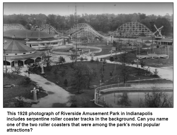 1928 photograph of Riverside Amusement Park in Indianapolis includes roller coaster tracks in the background. Can you name one of the two roller coasters in the park?