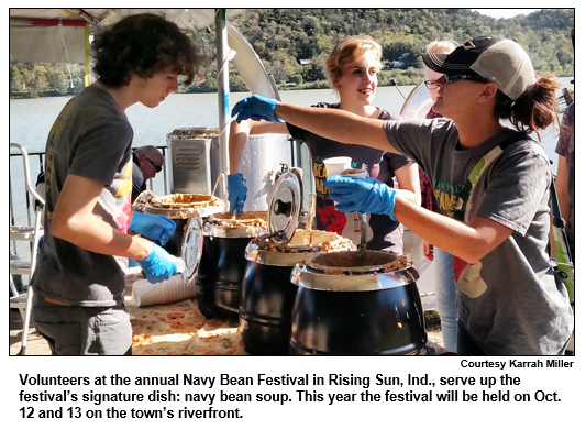 Volunteers at the annual Navy Bean Festival in Rising Sun, Ind., serve up the festival's signature dish: navy bean soup. This year the festival will be held on Oct. 12 and 13 on the town's riverfront. Courtesy Karrah Miller.