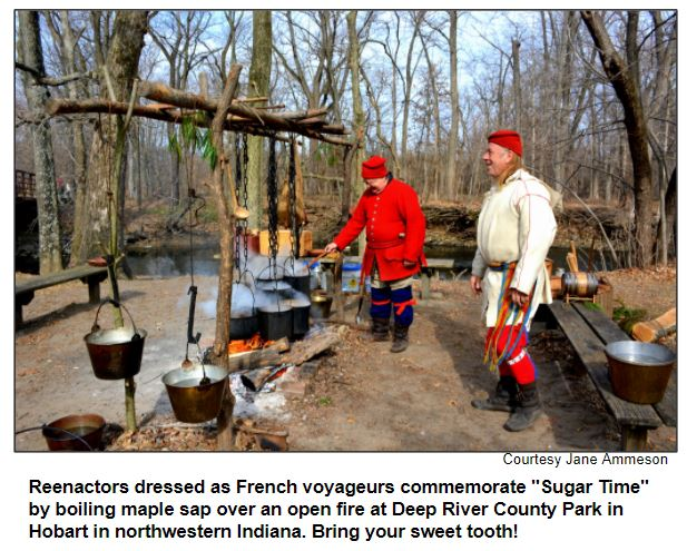 """Reenactors dressed as French voyageurs commemorate """"Sugar Time"""" by boiling maple sap over an open fire at Deep River County Park in Hobart in northwestern Indiana. Bring your sweet tooth! Courtesy Jame Ammeson."""