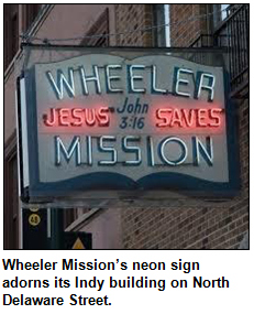 Wheeler Mission's neon sign adorns its Indy building on North Delaware Street.