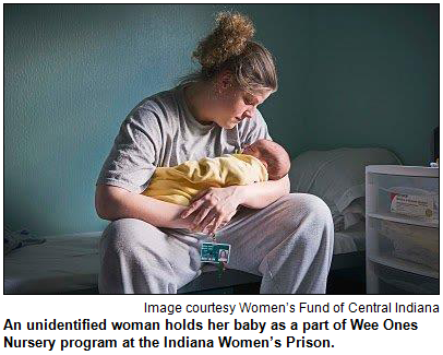 An unidentified woman holds her baby as a part of Wee Ones Nursery program at the Indiana Women's Prison. Image courtesy Women's Fund of Central Indiana.